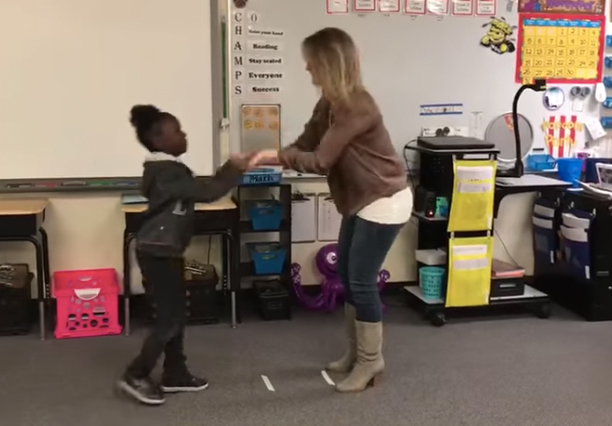 Teacher Shows Off Individual Handshakes For Every Kid In Class teacher handshakes