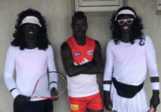 Footballers dress in blackface.