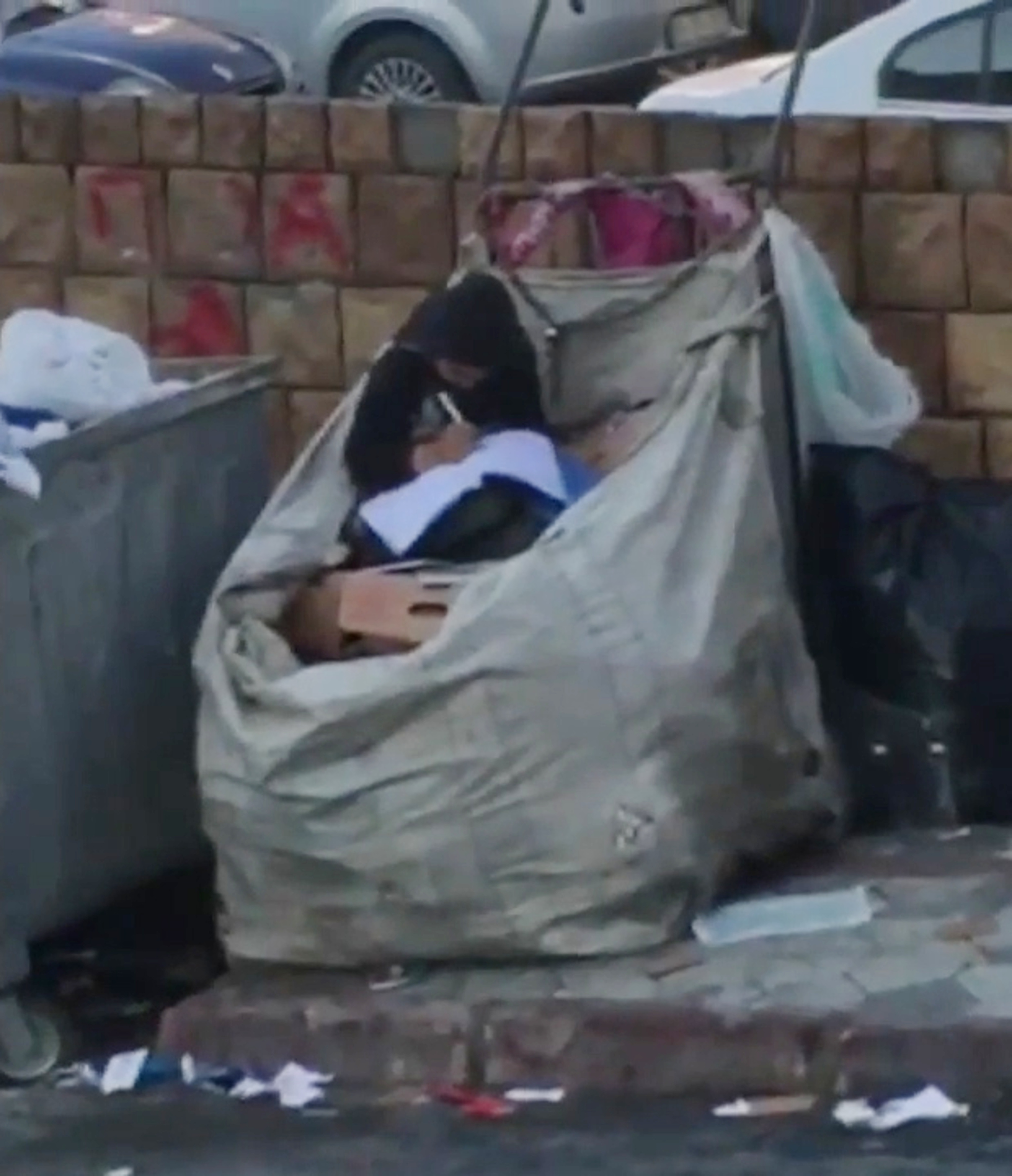 Syrian refugee studies in pile of rubbish