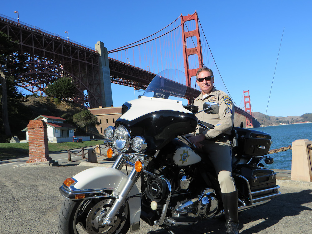 kevin briggs on his bike on the golden gate bridge
