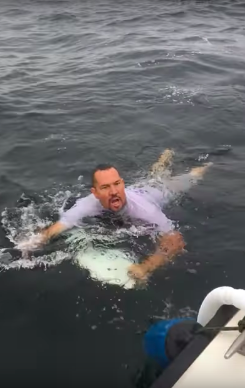 Man jumps into sea for fish