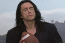 Wiseau holding a football
