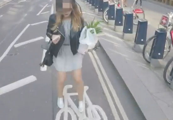 Guy uses air horn to get pedestrians out of bike lane