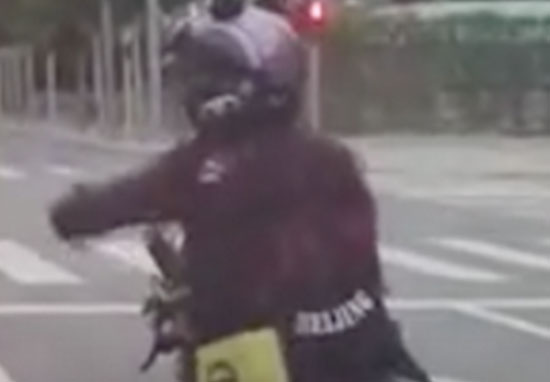 biker throws rubbish through car window