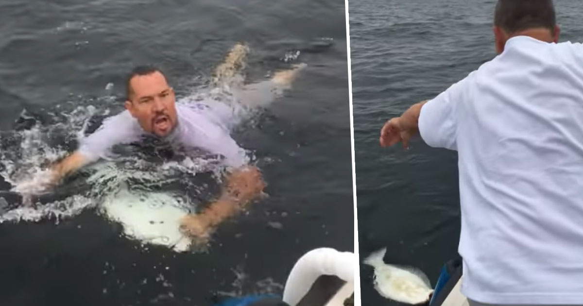 man jumps in sea for fish