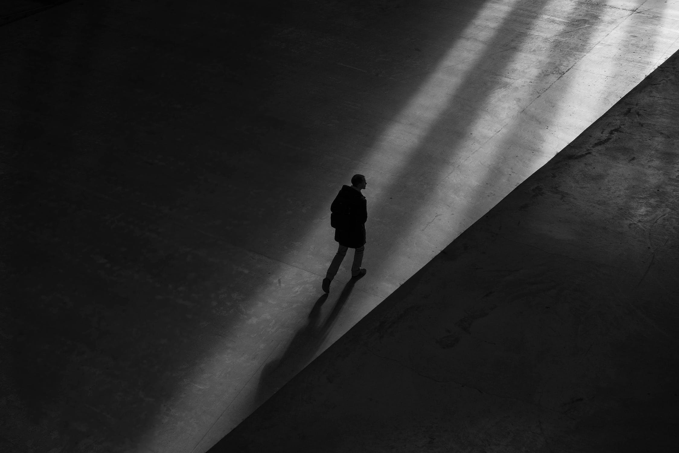 Man walking through light shaft