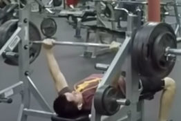 Guy bench presses 165 kilos