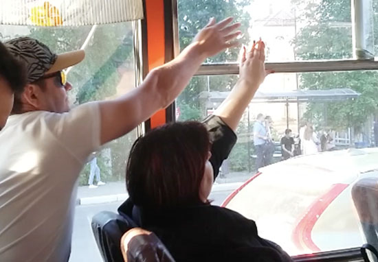 Bus passengers fight over window