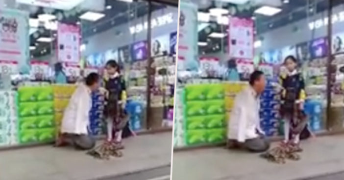 Little girl helps man with no arms.