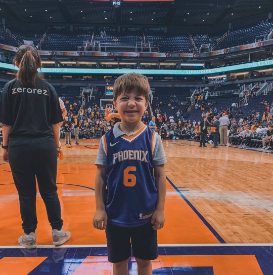 Boy who had lonely birthday party at basketball match