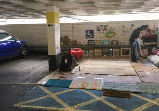 Man turns car park into home