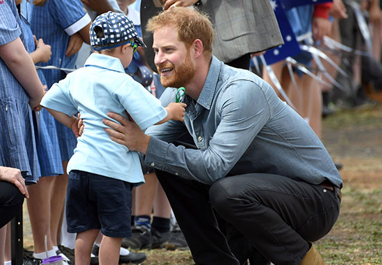 Young fan strokes prince Harry's beard