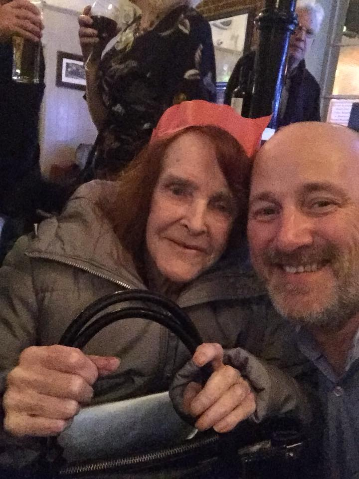 Pub owner with elderly woman at free christmas lunch