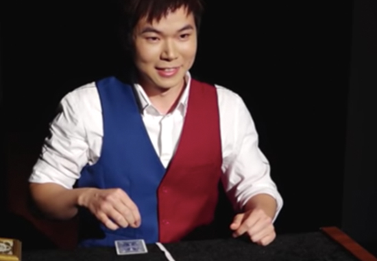 Magician wows judges at magic Olympics.