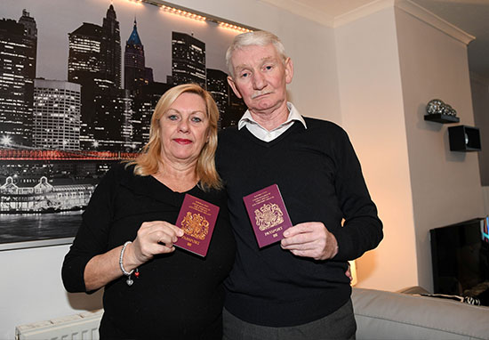 couple holding passports