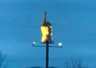 Guy flips off town with middle finger sculpture
