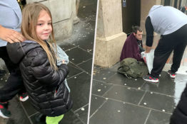 Young Girl hands out food to homeless people 1