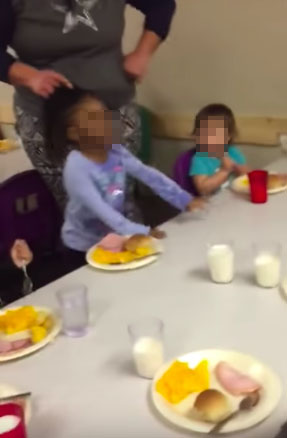 Little girl forced to eat by having hair pulled