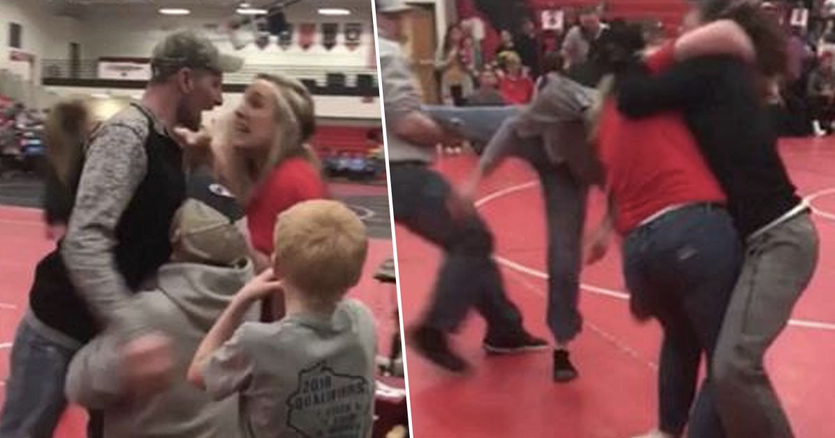 Adults fighting at wrestling tournament