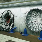 Punched-In Wall Art At Train Station Shows Damage Done By Goku, Luffy And Naruto