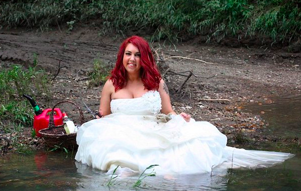 Divorced woman burns wedding gown.