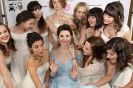 Guests wear wedding dresses to wedding