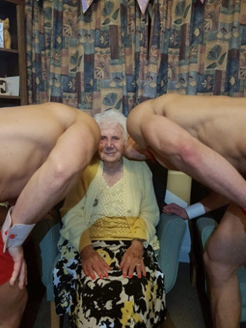 Elderly woman hires hunks in trunks.