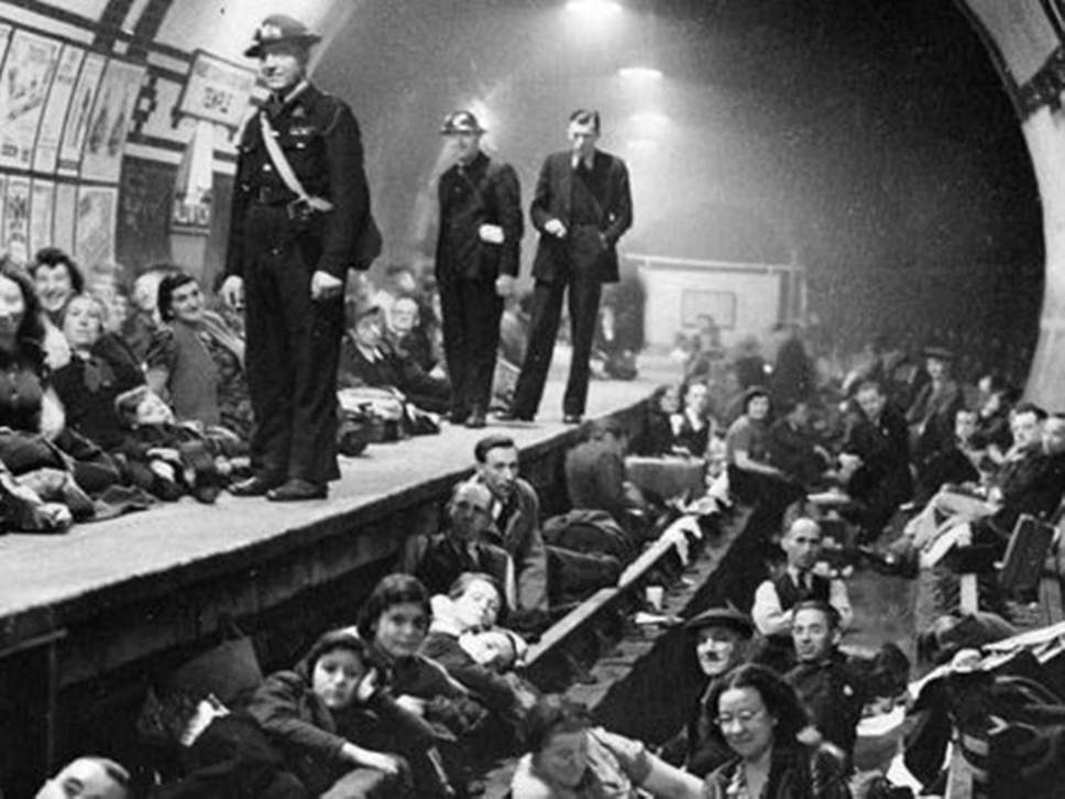 People taking cover in underground stations during WWII air raids