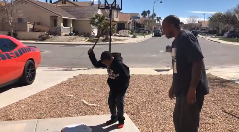 Dad Forces Son To Smash PlayStation With Boulder As Punishment
