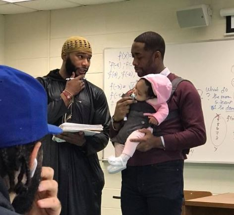 Professor looks after student's baby
