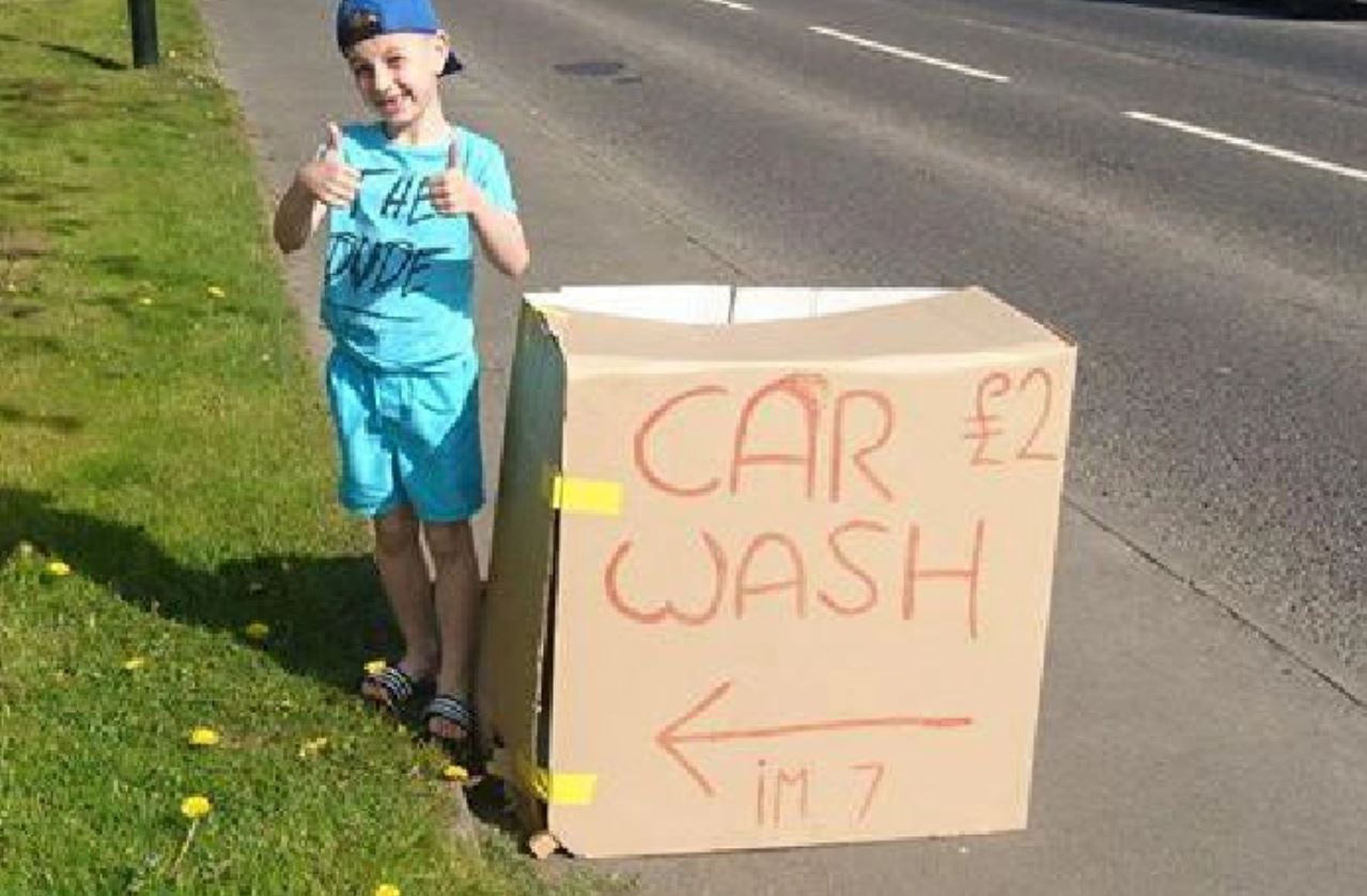 Boy sets up car wash