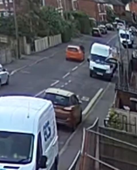 Car rams biker into van