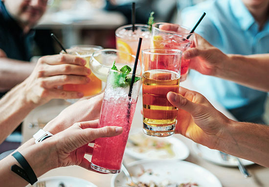 Group of people holding drinks