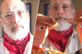 Tom Hanks signing Toy Story Woody figures for conjoined twins