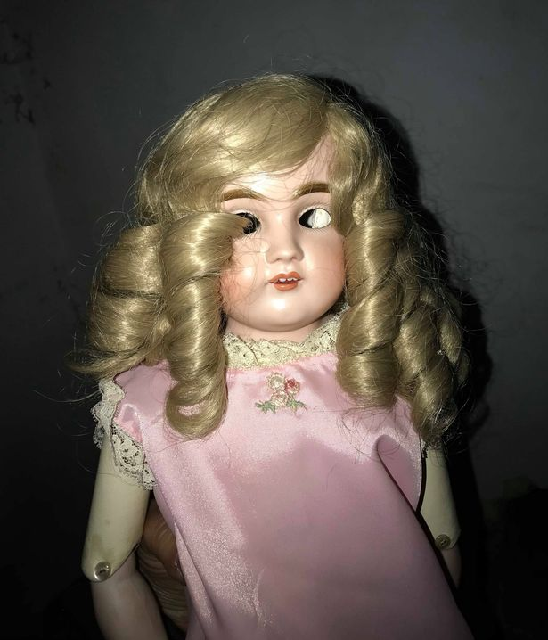 creepy doll with no eyes