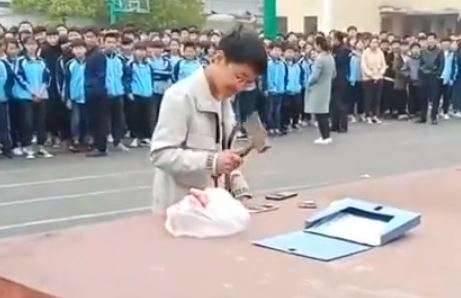 Students forced to smash phones after being caught on them in class
