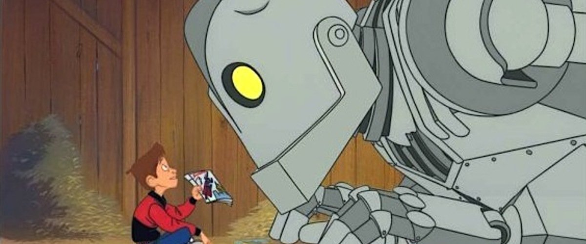 the iron giant looking at comic books
