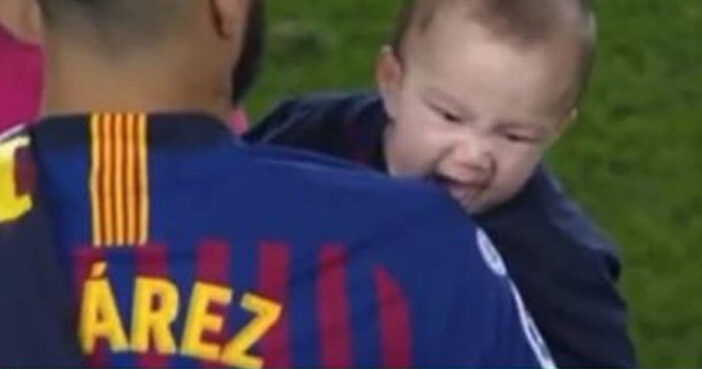 Luiz Suarez' son bites him after match.