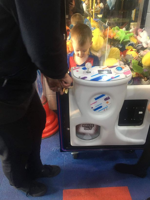 boy inside claw machine trapped