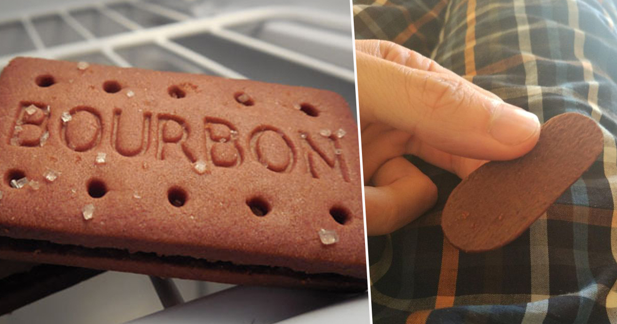 Man separates bourbon biscuit