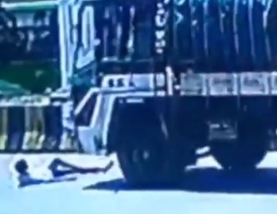 Boy avoids motorbike but gets hit by lorry