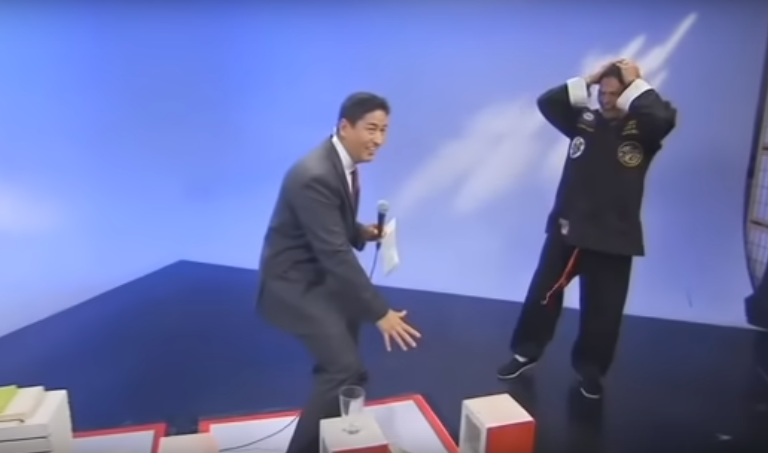 news anchor accidentally reveals fake Kung Fu trick on TV