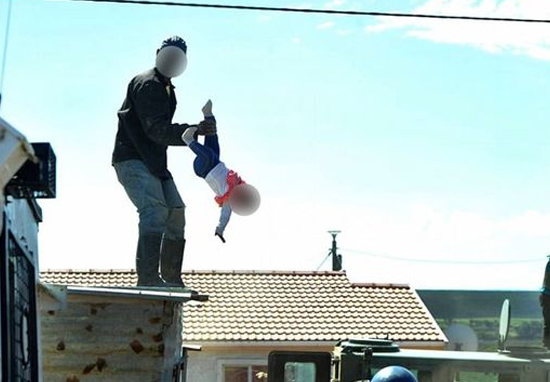 Dad throws baby off roof