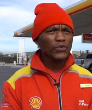 Gas station attendant helps stranded woman.