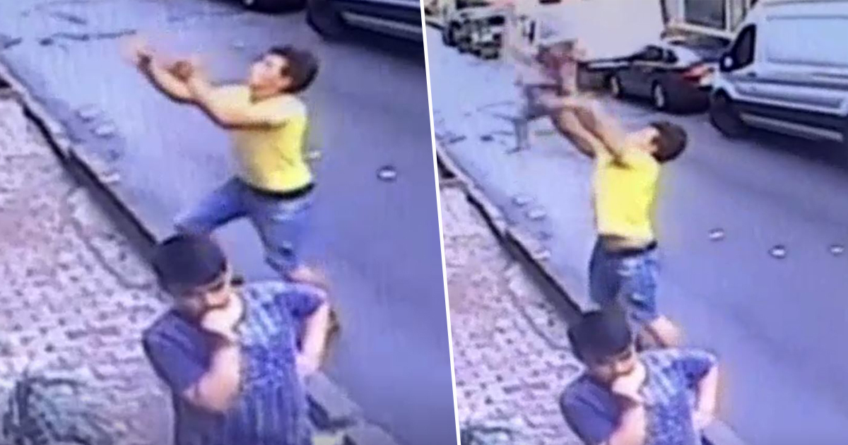 man catching toddler who fell from window