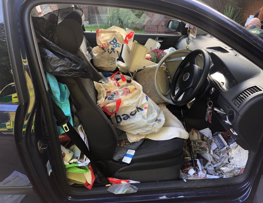 Driver crashes because of trash in car