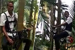 man on motorbike engine tree climbing device