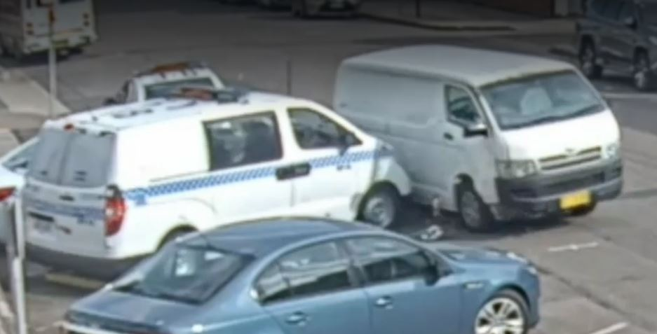 Van crashes into police cars