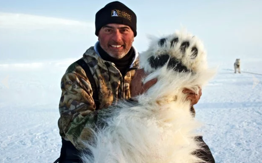 trophy hunter with polar bear