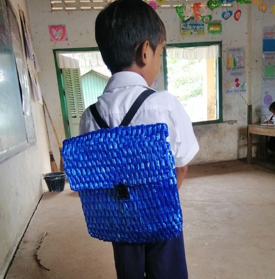 Dad weaves backpack for son